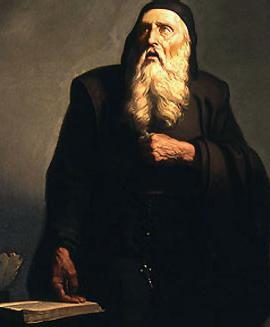 Ramon Llull with a long, white bear and a black hooded garmet