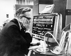 Tom Kilburn in front of Manchester Atlas computer console in 1962