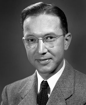 William Alfred Higinbotham, inventor & physicist, smiling for a professional portrait
