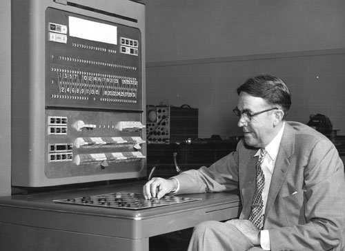 Arthur Samuel plays checkers with an IBM 704 computer
