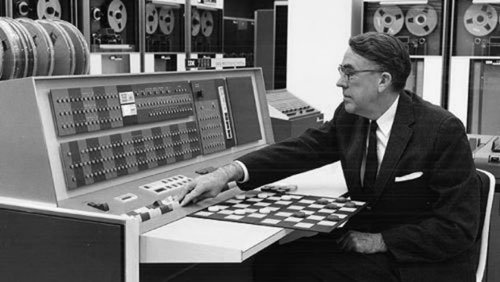 Arthur Samuel plays checkers with an IBM computer
