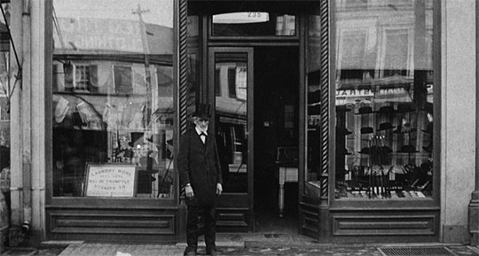 Henry Beardsley standing in front of his store in Ohio (a photo from 1887)