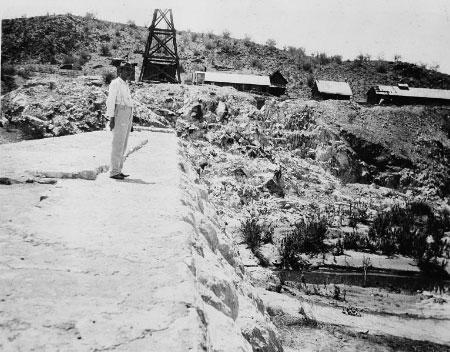 William Beardsley standing standing atop Diversion Dam