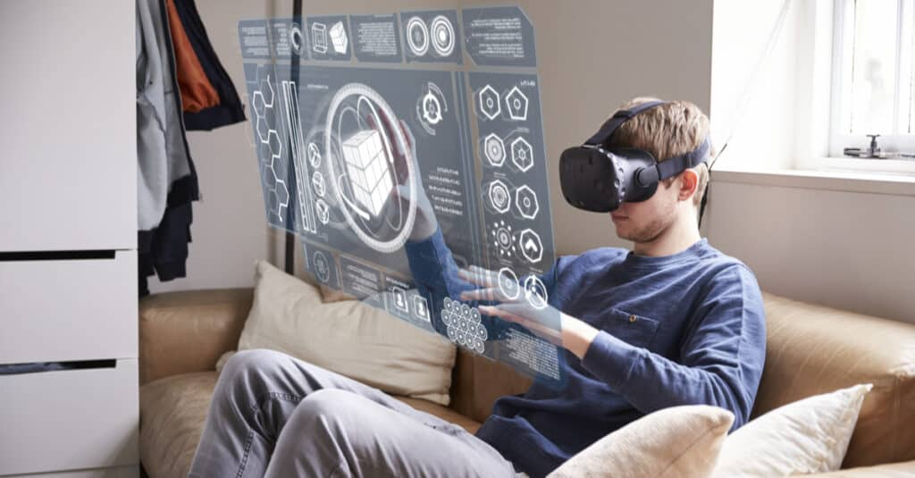 Man using virtual reality on his couch